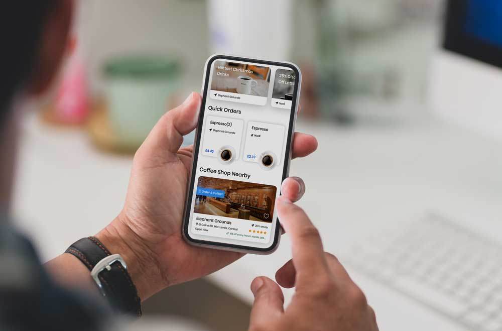BrewRound-coffee-shop-app-in-hand